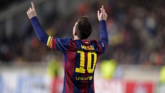 Barcelona's Lionel Messi celebrates on his way to yet another hat trick - and yet another record (Reuters)