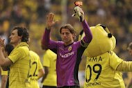 Dortmund's goalkeeper Roman Weidenfeller (C) celebrates after their German first division Bundesliga match vs Hanover 96 in the western German city of Dortmund, on April 2. League leaders Dortmund are facing a tough clash at Hamburg on Saturday
