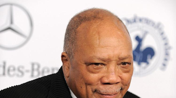 FILE - This Oct. 20, 2012 file photo shows music producer Quincy Jones arrives at The Carousel of Hope at The Beverly Hilton Hotel in Beverly Hills. Jones says he has co-created the music version of Rosetta Stone. The 80-year-old composer and producer launched a new music education application Tuesday, Feb. 19, 2013, called Playground Sessions, which teaches users how to play the piano. (Photo by Jordan Strauss/Invision/AP, file)