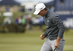 Jordan Spieth reacts after his par putt on the 17th hole. (REUTERS)