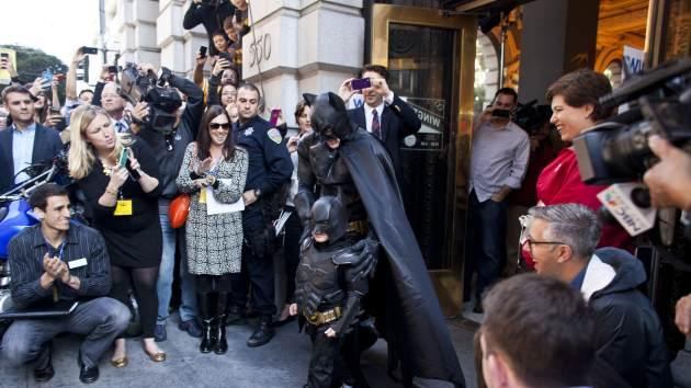5-year-old leukemia survivor Miles, also known as BatKid and Batman leave a former bank after arresting the Riddler November 15, 2013 in San Francisco -- Getty Images