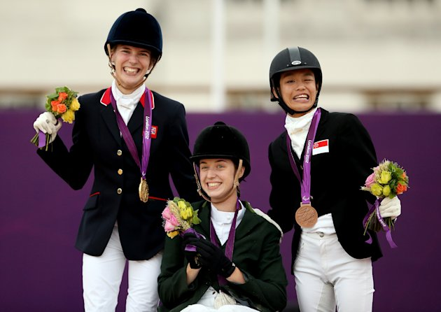 Sophie Christiansen of Great Britain (L) with Helen Kearney of Ireland (C) and Laurentia Tan of Singapore during the Dressage Individual Championship Test Grade Ia on day 4 of the London 2012 Paralympic Games (Getty Images)