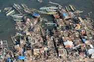 This aerial photo shows destroyed houses along the water in the town of Guiuan in Eastern Samar province in the central Philippines on November 11, 2013