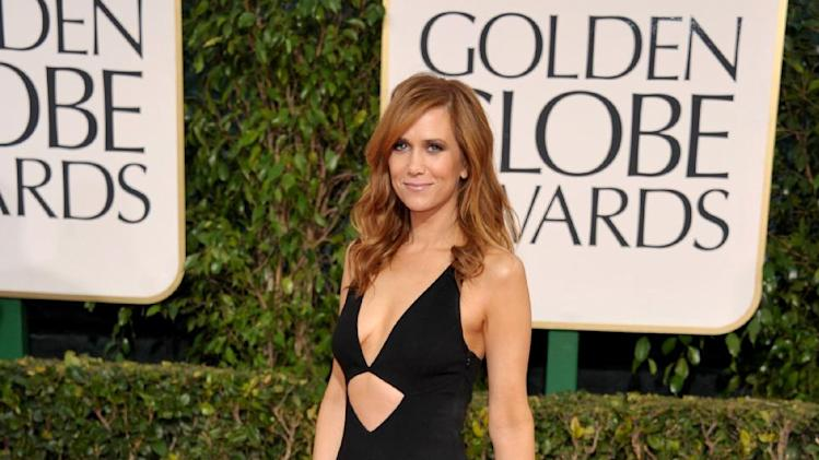 Actress Kristen Wiig arrives at the 70th Annual Golden Globe Awards at the Beverly Hilton Hotel on Sunday Jan. 13, 2013, in Beverly Hills, Calif. (Photo by John Shearer/Invision/AP)