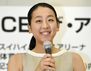 Japanese figure skater Mao Asada speaks during a press conference in Tokyo, Monday, May 18, 2015. Olympic silver medalist Asada will attempt a comeback to competitive skating after taking a year off from the sport. Speaking at a news conference Monday, Asada said she misses competition and decided by herself to attempt a comeback. (Kyodo News via AP)
