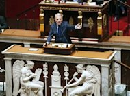 "Prime Minister Jean-Marc Ayrault, pictured in the Assemblee Nationale in Paris, has urged the French to rally behind efforts to tackle a ""crushing"" debt burden after an audit warned of a 43 bn euro budget hole"