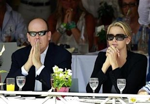 Monaco's Prince Albert II and his fiancee Charlene Wittstock attend the Jumping International of Monte Carlo in Mon onaco's Prince Albert II and his fiancee Charlene Wittstock attend the Jumping International of Monte Carlo in Monaco. (Reuters)