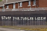 Anti-monarchy graffiti pictured on a wall in west Belfast, Northern Ireland. Queen Elizabeth II is poised to make a historic gesture in Northern Ireland's peace process when she shakes the hand of former IRA commander Martin McGuinness
