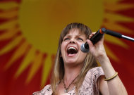 CORRECTS SPELLING OF FIRST NAME TO ALLEN INSTEAD OF ALLAN - Theresa Andersson performs with Allen Toussaint at the New Orleans Jazz and Heritage Festival in New Orleans, Saturday, May 5, 2012. (AP Photo/Gerald Herbert)