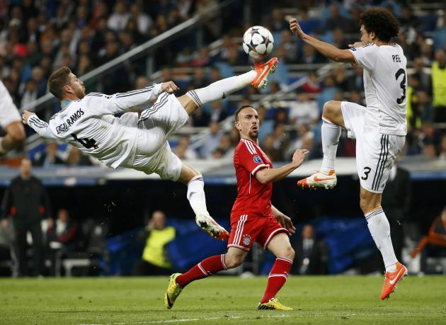 Real Madrid's Sergio Ramos jumps to block a pass from Bayern Munich's Frank Ribery as Pepe watches during their Champions League semi-final first leg soccer match at Santiago Bernabeu stadium