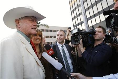 Hagman and Gray are interviewed as they arrive for a VIP Preview party for the Collection of Larry Hagman at Julien's Auctions in Beverly Hills