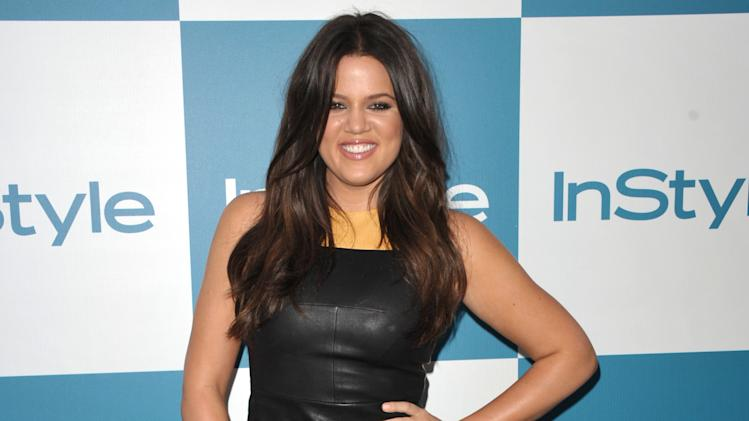 "FILE - In this Aug. 8, 2012 file photo, Khloe Kardashian attends the InStyle Summer Soiree at The London Hotel, in West Hollywood, Calif.  ""Extra"" host, Mario Lopez and ""Keeping Up with the Kardashians,"" co-star, Khloe Kardashian Odom, will host the second season of the Fox talent competition, ""The X-Factor."" The network said Tuesday, Oct. 16, 2012, that Odom and Lopez will first appear as hosts during the show's live broadcasts beginning this November. (Photo by John Shearer/Invision/AP, File)"