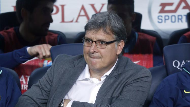 "Barcelona's Gerardo ""Tata"" Martino watches their La Liga soccer match against Athletic Bilbao at Camp Nou stadium in Barcelona"