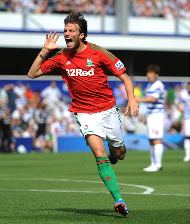 Michu scored the first goal of the new Premier League season before getting Swansea's second
