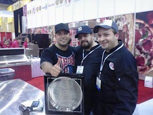 Andrew and his Goodfella's team celebrate their win at the Pizza Expo.