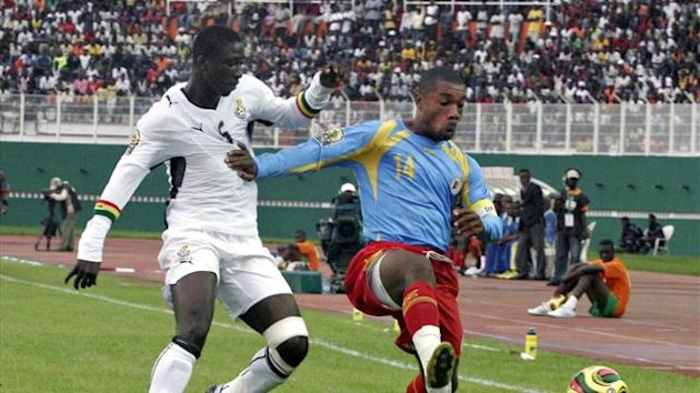 Ghana's Ofosu fights for ball with Democratic Republic of Congo's Bongeli in Abidjan