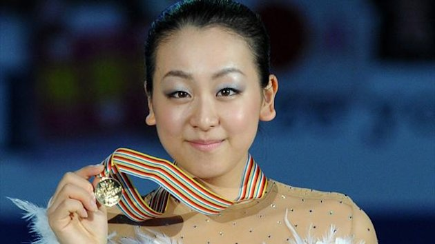 Ladies winner Japan's Mao Asada poses with her gold medal during the awarding ceremony of the Four Continents figure skating championships in Osaka,