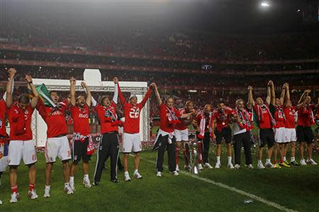 Benfica's players celebrate with the trophy after beating Olhanense and winning the Portuguese Premier League title at Luz stadium in Lisbon
