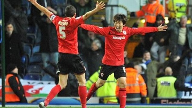 Cardiff City's Bo-Kyung Kim (right) celebrates scoring with team-mate Mark Hudson (PA)