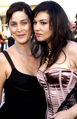 Premiere: Carrie Anne Moss has her personal space encroached on by Monica Bellucci at the Hollywood premiere of Warner Brothers' The Matrix: Reloaded - 5/7/2003