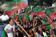 Imran Khan (centre) shakes supporters' hands during a rally in Mianwali, northern Pakistan. Khan, who heads the Pakistan Tehreek-e-Insaaf (PTI) or Movement for Justice party, on Sunday urged anti-drone activists to remain peaceful and to seek no confrontation with the authorities.