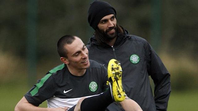 Celtic's Scott Brown (L) and Georgios Samaras laugh during a training session at their training facility in Lennoxtown (Reuters)