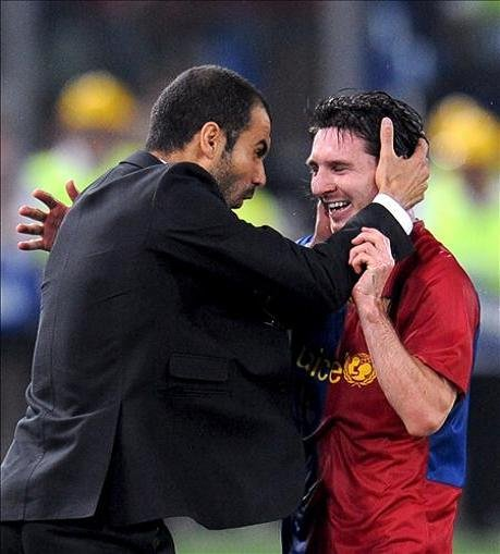 Pep Guardiola and Lionel Messi celebrate in the Clasico win in May 2009