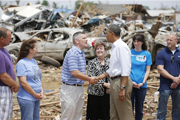 President Barack Obama greets Robert Romines, Asst. Superintendent, Personnel for Moore Schools, and Susan Pierce, Superitendent of Moore Schools, and tornado victims at Plaza Towers Elementary in Moo