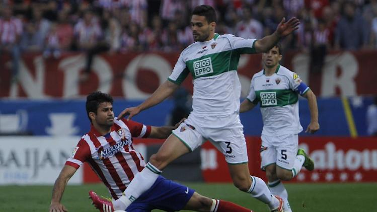 Elche's Botia, right, in action with Atletico's Diego Costa, left, during a Spanish La Liga soccer match between Atletico de Madrid and Elche at the Vicente Calderon stadium in Madrid, Spain, Friday, April 18, 2014
