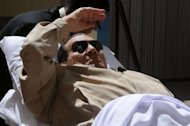 Former Egyptian president Hosni Mubarak is wheeled out of a courtroom following his verdict hearing in Cairo. Mubarak and his security chief were given life in prison over the deaths of protesters in 2011, but the acquittal of six police chiefs sparked calls for mass protest