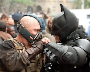 Tom Hardy as Bane and Christian Bale as Batman