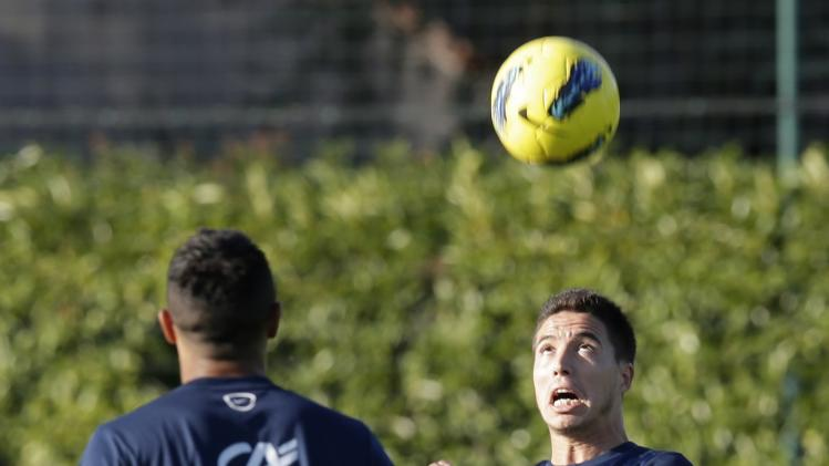 France's national soccer team player Samir Nasri heads the ball during a training session in Clairefontaine