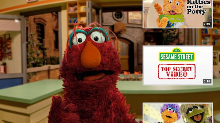 "This image from video released by Sesame Workshop shows the character Telly from the children's show ""Sesame Street.""  The children's program is closing in on a kind of rarified digital milestone usually reserved for the likes of pop stars and ""Gangnam Style."" ""Sesame Street"" will soon pass 1 billion views on YouTube. (AP Photo/Sesame Workshop)"