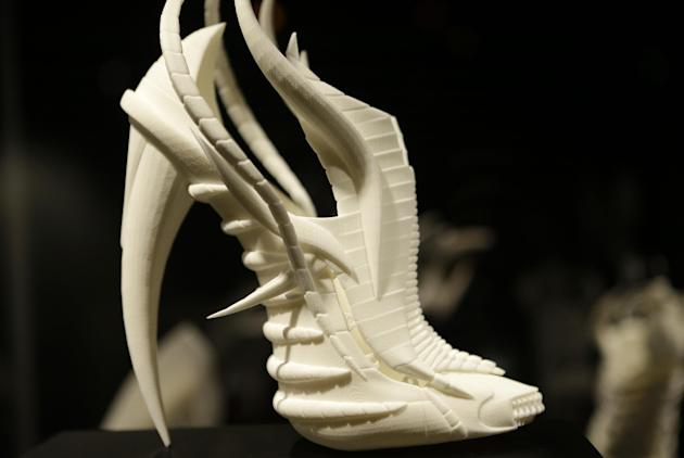 "This Feb. 11, 2013 photo shows Janina Alleyne's ""Exoskeleton"" shoe on display at the ""Shoe Obsession"" exhibit at The Museum at the Fashion Institute of Technology Museum in New York. The exhibition, s"