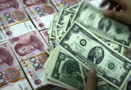 A bank teller counts stacks of US dollars and Chinese yuan at a bank in Huaibei. The Bank of China (BOC) denied Thursday reported allegations that it helped funnel millions of dollars to Palestinian group Hamas