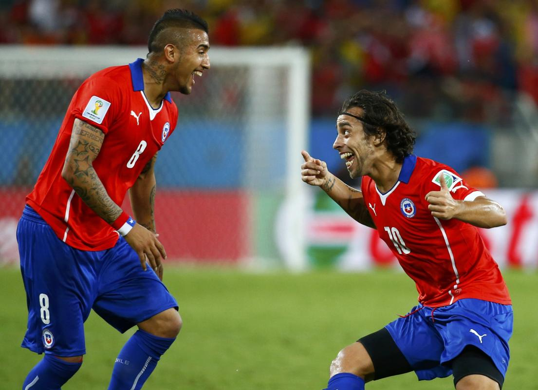 Chile's Jorge Valdivia celebrates their second goal during their 2014 World Cup Group B soccer match against Australia at the Pantanal arena in...