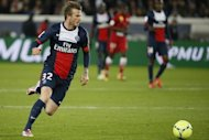 David Beckham runs during a French L1 football match between Paris St Germain and Brest on May 18, 2013 in Paris. The recently retired football superstar will be making a seven-day visit to China next week, reports said Friday