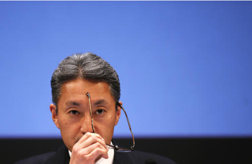 Sony Corp President and CEO Hirai takes off his glasses during a news conference at the company's headquarters in Tokyo