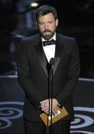 Ben Affleck presents an award during the Oscars at the Dolby Theatre on Sunday Feb. 24, 2013, in Los Angeles.  (Photo by Chris Pizzello/Invision/AP)