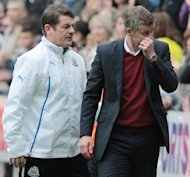 Cardiff City manager Ole Gunnar Solskjaer (R) reacts at the end of their 3-0 English Premier League defeat against Newcastle at St James' Park on May 3, 2014
