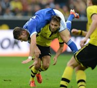 Schalke's Roman Neustaedter and Dortmund's Moritz Leitner fight for the ball during their German first division Bundesliga match in the western German city of Dortmund, on October 20. After the highs of their impressive midweek Champions League triumphs, Borussia Dortmund and Schalke return to domestic action trying to close the gap behind the league leaders, Bayern Munich