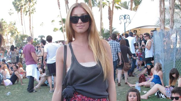 Celebrities at festivals photos: Whitney Port worked some LA cool in floral shorts, over-sized vest, pouch bag and A-lister must-have: sunnies.