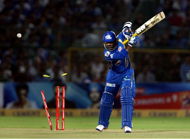 Mumbai Indians batsman Dinesh Karthik bowled by Vikramjeet Singh during the CLT20 match against Rajasthan Royals at Sawai Mansingh Stadium, Jaipur on Sept. 21, 2013. (Photo: IANS)