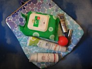 My beauty packing musts loaded into a Sonia Kashuk clutch.