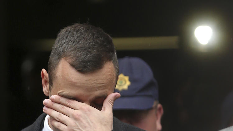Oscar Pistorius, leaves the high court in Pretoria, South Africa, Monday, April 14, 2014. Pistorius is charged with murder for the shooting death of his girlfriend, Reeva Steenkamp, on Valentines Day in 2013. (AP Photo/Themba Hadebe)