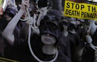 A poster against the death penalty is displayed in Singapore in 2011. Rights groups on Tuesday hailed Singapore's decision to ease mandatory death sentences for homicide and drug trafficking but urged the government to go further and totally abolish capital punishment