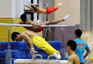 Gymnasts train for the 2012 Chinese Olympic team at the Sports Administration training centre, in Beijing in 2011. China's Olympic athletes and coaches must vow to reject performance enhancing substances and pass an exam on doping if they want to participate in the London Games, state press said