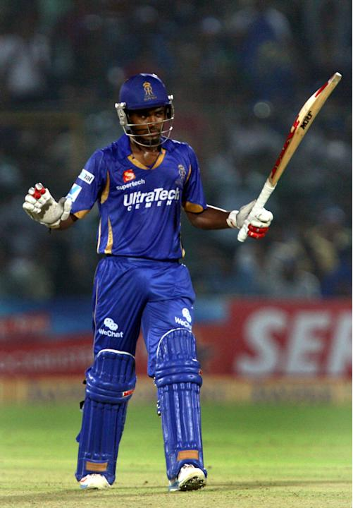 Rajasthan Royals batsman Sanju Samson celebrates half century during the CLT20 match against Mumbai Indians at Sawai Mansingh Stadium, Jaipur on Sept. 21, 2013. (Photo: IANS)