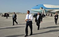 US President Barack Obama walks across the tarmac to greet well-wishers upon arrival at West Palm Beach International Airport July 19, in West Palm Beach, Florida. Obama warned of cyber threats to critical US infrastructure and called on Congress to take action in an op-ed published Friday in the Wall Street Journal