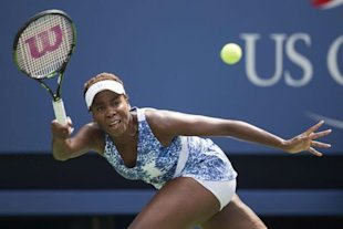 Venus Williams of the U.S. hits a return to Monica Puig of Puerto Rico during their match at the U.S. Open Championships tennis tournament in New York, August 31, 2015. REUTERS/Carlo Allegri